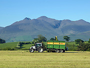 Under Carrauntoohill Mountain silage cutters make light of the their work on Sean O'Connor's farm at Ballymalis, Beaufort, County Kerry, Ireland.<br /> Photo: Don MacMonagle