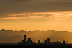North America, United States, Washington, Seattle, downtown skyline and Olympic Mountains viewed from Bellevue at sunset