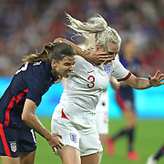 United States forward Tobin Heath (17) and England defender Alex Greenwood (3) fight for the ball during the first match of the 2020 She Believes Cup soccer tournament at Exploria Stadium on 5 March 2020 in Orlando, Florida USA.