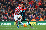 Ibrahim Afellay of Stoke City and Raheem Sterling of Manchester City battle for the ball. Barclays Premier league match, Stoke city v Manchester city at the Britannia Stadium in Stoke on Trent, Staffs on Saturday 5th December 2015.<br /> pic by Chris Stading, Andrew Orchard sports photography.