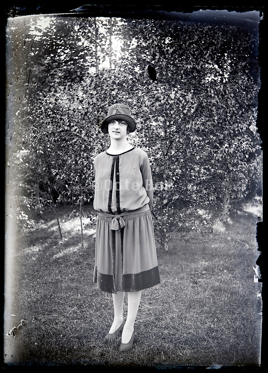 fashionable dressed adult woman standing in a garden France circa 1920s