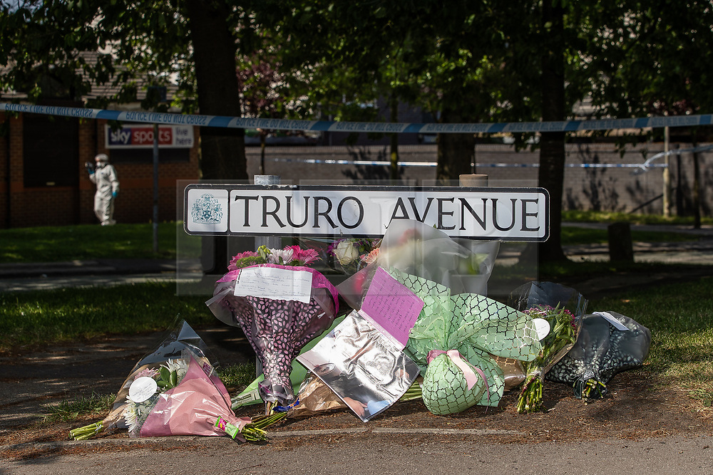 © Licensed to London News Pictures. 28/05/2018. Stockport, UK. Flowers and tributes left at the scene outside The Salisbury Club on Truro Avenue in the Brinnington area of Stockport, Greater Manchester, where a car collided with pedestrians late last night, killing one man and injuring others.  A murder investigation has been launched. Police later recovered a black Audi A4 which fled the scene. Photo credit: Joel Goodman/LNP