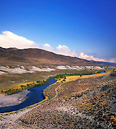 The deep blue water of the Truckee River as it ambles through the Nevada desert just to the south of Pyramid Lake, USA