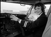 First Aer Lingus Female Pilot.    (M70)..1979..29.04.1979..04.29.1979..29th April 1979..Ms Grainne Cronin formerly a stewardess with Aer Lingus takes up her new role as the first female pilot with the airline. Ms Cronin from Ennis,Co Clare is the daughter of Aer Lingus Captain, Mr Phelim Cronin..Image shows Ms Cronin taking control of a Boeing 737 from the co-pilot chair...Note. Ms Cronin, in her career reached the rank of Captain in 1988. Her last flight saw her Captain an all female crew aboard an Airbus A330 on the Dublin / Boston route. She retired after 33 years of service.