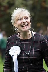© Licensed to London News Pictures. 26/10/2017. LONDON, UK.  TRACEY BRABIN MP reacts after winning first prize with her dog, Rocky at the Westminster Dog of the Year Competition held in Victoria Tower Gardens. The Westminster Dog of the Year Competition is organised jointly by the Kennel Club and the Dogs Trust..  Photo credit: Vickie Flores/LNP