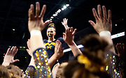 Natalie Wojcik of the Michigan Wolverines celebrates with teammates after her beam routine at the Elevate the Stage meet at the Huntington Center on February 23, 2019 in Toledo, Ohio.