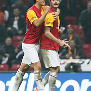 Galatasaray's Albert Riera Ortega (R) celebrate his goal with team mate during their Turkish Super League soccer match Galatasaray between MKE Ankaragucu at the TT Arena at Seyrantepe in Istanbul Turkey on Wednesday, 25 January 2012. Photo by TURKPIX