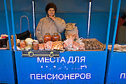 Yekaterinburg, Russia, 02/04/2006..Pensioner selling food products at a special section at Shartashky Market.