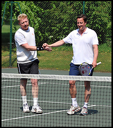 The Prime Minister David Cameron and Boris Becker play in a charity Tennis match at Chequers, Saturday April 30 2011. Photo By Andrew Parsons / i-Images.