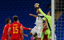 CARDIFF, WALES - Wednesday, November 18, 2020: Finland's Paulus Arajuuri (L) and Wales'  goalkeeper Daniel Ward (R) during the UEFA Nations League Group Stage League B Group 4 match between Wales and Finland at the Cardiff City Stadium. Wales won 3-1 and finished top of Group 4, winning promotion to League A. (Pic by David Rawcliffe/Propaganda)