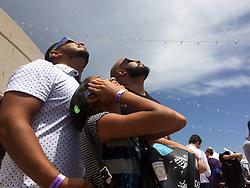 Jeremy Garcia, Alanii Garcia and Genesis Martinez check out the solar eclipse on the terrace of the Orlando Science Center on Monday, Aug. 21, 2017. Photo by Marco Santana/Orlando Sentinel/TNS/ABACAPRESS.COM