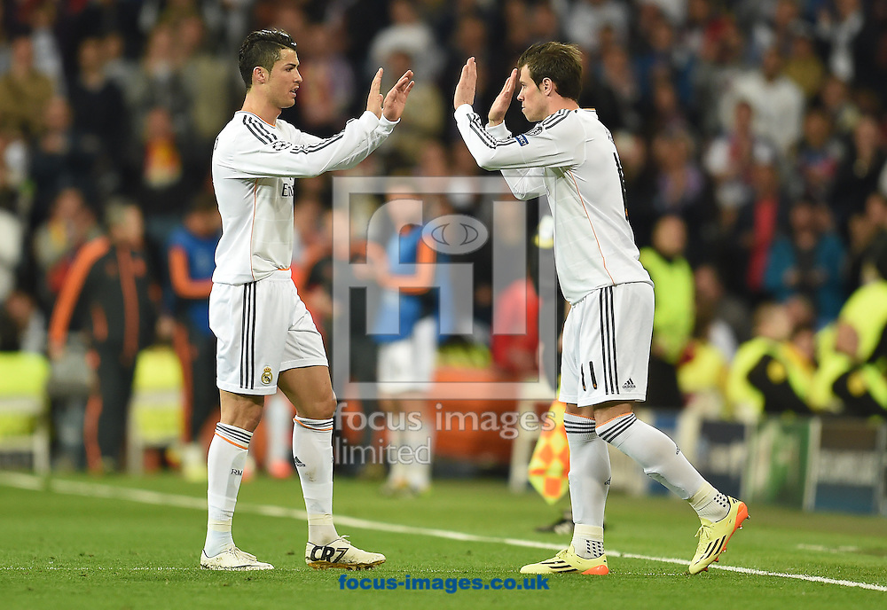 Cristiano Ronaldo and Gareth Bale of Real Madrid during the UEFA Champions League match against Bayern Munich at the Estadio Santiago Bernabeu, Madrid<br /> Picture by Andrew Timms/Focus Images Ltd +44 7917 236526<br /> 23/04/2014