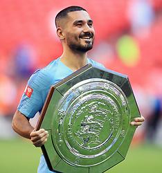 Manchester City's Ilkay Gundogan celebrates with the Community Shield after winning the Community Shield match at Wembley Stadium, London.