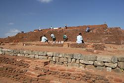Men Rebuilding Ancient City of Sigiriya