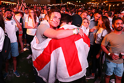 © Licensed to London News Pictures. 11/07/2018. London, UK. England fans in Flat Iron Square, London, react as England lose against Croatia in extra time in the World Cup semi-final. Photo credit: Rob Pinney/LNP