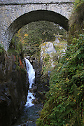 France, The Pyrenees Mountains, Le Pont d'Espagne (Spanish Bridge) with a waterfall in the background