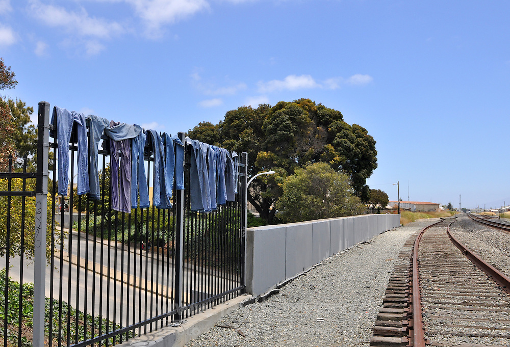 An evocative reminder we all have the same needs - a homeless person's fresh-washed jeans hang up to dry on an East Alisal railroad overpass near Market Street in Salinas. She washed and wrung them out by hand in a five-gallon bucket, using water borrowed from a nearby building.