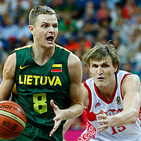 08 August 2012: Lithuania Renaldas Seibutis drives past Russia Andrei Kirilenko during Team Russia vs Team Lithuania, during the men's basketball quarter-finals, at the 02 Arena, in London, Great Britain.