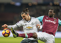 Football - 2016 / 2017 Premier League - West Ham United vs. Manchester United<br /> <br /> Zlatan Ibrahimovic of Manchester United and Pedro Obiang of West Ham compete for the ball at The London Stadium.<br /> <br /> COLORSPORT/DANIEL BEARHAM