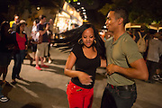 A young couple dancing to salsa near the store and refreshment area. The area in front of the stage, which had been intended for dancing, was filled with standees.