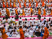 08 SEPTEMBER 2013 - BANGKOK, THAILAND:  Buddhist monks walk through a sea of people during a mass alms giving ceremony in Bangkok Sunday. 10,000 Buddhist monks participated in a mass alms giving ceremony on Rajadamri Road in front of Central World shopping mall in Bangkok. The alms giving was to benefit disaster victims in Thailand and assist Buddhist temples in the insurgency wracked southern provinces of Thailand.     PHOTO BY JACK KURTZ