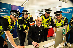 Pictured: Inspec tor Alan Carson, PC Louise Gordon, PC Martin Wood and Sargent Kevin Smith watched as Phil, Gormley completed the survey<br /> Police Scotland Chief Constable Phil Gormley unveiled details of the 'Your View Counts' exercise, which will help shape policing priorities throughout the country in Edinburgh today. <br /> Ger Harley   EEm 7 April 2016