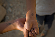 Coptic Christians cross tattooed on both wrists to show their religious beliefs.