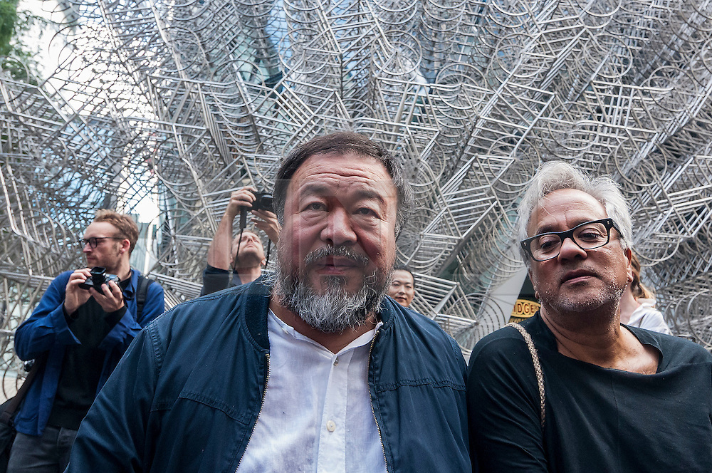 © Licensed to London News Pictures. 17/09/2015. London, UK. Internationally renowned artists, Ai Weiwei and Anish Kapoor, seen next to Ai Weiwei's recently unveiled bicycle sculptutre at The Gherkin, mark their solidarity for refugees in the current crisis by leading a walk from the Royal Academy of Arts in Piccadilly to Stratford, passing many of London's landmarks en route. Photo credit : Stephen Chung/LNP