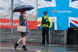 30/09/2017. Manchester, UK. Police guard the venue on the eve of The Tory Party Conference. Pro-peace, anti-austerity, anti-war protests, including rallies, public meetings, comedy, music, & culture, take place during the four days of the Conservative Party Conference in Manchester, UK. 1st - 4th Oct 2017. The protest festival has been organised by The People's Assembly. Photo credit: Graham M. Lawrence/LNP