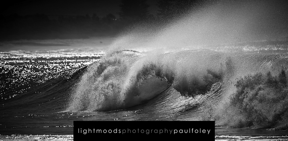 Empty hollow wave breaking in morning light at Gerringong, east coast, Australia