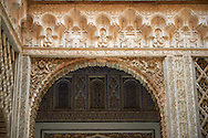 Arabesque Mudjar plasterwork of the 12th century Patio de las Muñecas (Courtyard of the Dolls), . Alcazar of Seville, Seville, Spain . The Royal Alcázars of Seville (al-Qasr al-Muriq ) or Alcázar of Seville, is a royal palace in Seville, Spain. It was built by Castilian Christians on the site of an Abbadid Muslim alcazar, or residential fortress.The fortress was destroyed after the Christian conquest of Seville The palace is a preeminent example of Mudéjar architecture in the Iberian Peninsula but features Gothic, Renaissance and Romanesque design elements from previous stages of construction. The upper storeys of the Alcázar are still occupied by the royal family when they are in Seville. <br /> <br /> Visit our SPAIN HISTORIC PLACES PHOTO COLLECTIONS for more photos to download or buy as wall art prints https://funkystock.photoshelter.com/gallery-collection/Pictures-Images-of-Spain-Spanish-Historical-Archaeology-Sites-Museum-Antiquities/C0000EUVhLC3Nbgw <br /> .<br /> Visit our MEDIEVAL PHOTO COLLECTIONS for more   photos  to download or buy as prints https://funkystock.photoshelter.com/gallery-collection/Medieval-Middle-Ages-Historic-Places-Arcaeological-Sites-Pictures-Images-of/C0000B5ZA54_WD0s