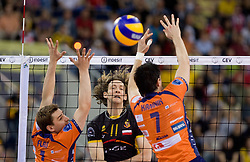 Stephane Antiga of Belchatow vs Andrej Flajs and Matevz Kamnik of ACH at  match for 3rd place of CEV Indesit Champions League FINAL FOUR tournament between PGE Skra Belchatow, POL and ACH Volley Bled, SLO on May 2, 2010, at Arena Atlas, Lodz, Poland.  (Photo by Vid Ponikvar / Sportida)