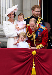 © Licensed to London News Pictures. 11/06/2016. London, UK. CATHERINE, DUCHESS OF CAMBRIDGE, PRINCESS CHARLOTTE, PRINCE GEORGE, PRINCE WILLAM and PRINCE HARRY on the balcony of Buckingham Palace, during the Trooping The Colour ceremony in London. This years event is part of a weekend of celebration to mark the 90th birthday of Queen Elizabeth II, who is Britain's longest reigning monarch. Photo credit: Ben Cawthra/LNP