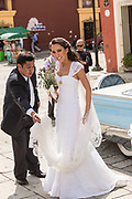 A beautiful bride in her wedding gown outside Santo Domingo de Guzmán Church in Oaxaca, Mexico.