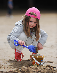 © Licensed to London News Pictures. 27/05/2013..Saltburn, England..Emily McGurk, 4, from Guisborough plays in the sand as she enjoys the warm bank holiday weather at Saltburn by the Sea in Cleveland....Photo credit : Ian Forsyth/LNP