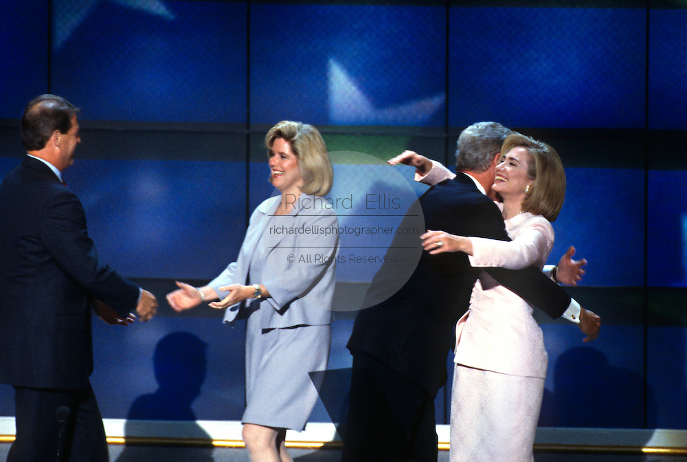 U.S President Bill Clinton hugs first lady Hillary Rodham Clinton and Vice President Al Gore embraces wife Tipper after they accepted the nomination for the democrat party at the 1996 Democratic National Convention August 29, 1996 in Chicago, IL.