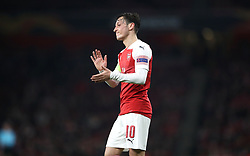 Arsenal's Mesut Ozil applauds the fans after the final whistle during the UEFA Europa League round of 32 second leg match at the Emirates Stadium, London.