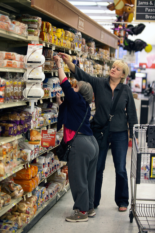 Companion Tonia Kulig, right, helps Mary Beth Solinski, a 59 year old, with Down Syndrome with her grocery shopping at Dominick's grocery store...Aging adults with Down Syndrome. In 1983, people with Down syndrome could expect to live to age 25. Today, their life expectancy is 60 years. We interview a 59-year-old patient who has outlived her parents and is now in AARP. She has trouble walking, but has lots of interests, such as cooking, arts and crafts and reading.