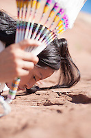 Photo by Elena Ray Native American Navajo Woman Yogini. Diné woman practicing yoga in her indigenous red earth environment.