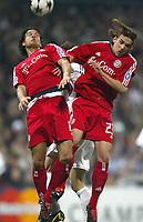 10/3/2004 Madrid, Spain.<br />Champions League,  8round, 2 Leg.<br />R.Madrid 1 - Bayern 0<br />R.Madrid's Solari in duel with Bayern's Ballack and Hargreaves at Santiago Bernabeu's Stadium.<br />© 2004 Alejandro leon Fernandez