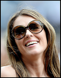 Liz Hurley with her partner Shane Warne watch the 2nd race at Ascot Races, Ascot, United Kingdom<br /> Saturday, 27th July 2013<br /> Picture by Andrew Parsons / i-Images
