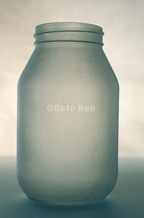 still life of frosted glass jar