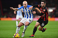 Lewis Cook (16) of AFC Bournemouth and Huddersfield Town midfielder Aaron Mooy (10) during the Premier League match between Bournemouth and Huddersfield Town at the Vitality Stadium, Bournemouth, England on 4 December 2018.
