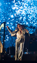 © Licensed to London News Pictures. 26/06/2015. Pilton, UK.  Florence and the Machine performing on the The Pyramid Stage stage at Glastonbury Festival 2015 on Friday Day 3 of the festival.  This years headline acts include Kanye West, The Who and Florence and the Machine, the latter being upgraded in the bill to replace original headline act Foo Fighters.   Photo credit: Richard Isaac/LNP
