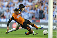 Curtis Davies of Hull City and Fernando Forestieri of Sheffield Wednesday slide in for the ball. Skybet football league Championship play off final match, Hull city v Sheffield Wednesday at Wembley Stadium in London on Saturday 28th May 2016.<br /> pic by John Patrick Fletcher, Andrew Orchard sports photography.