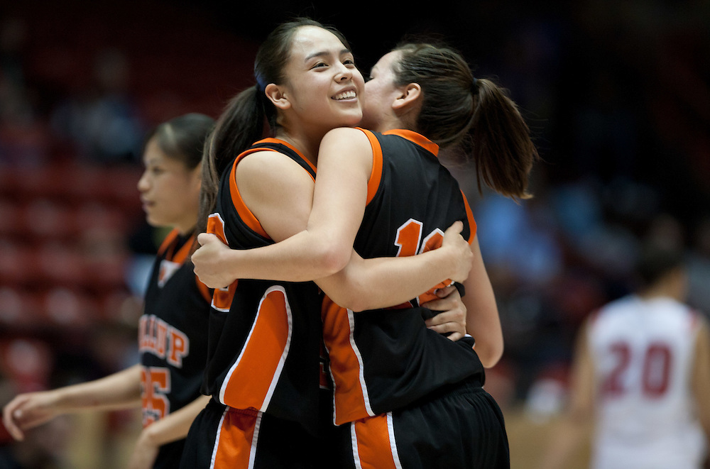 Robyn Antone hugs Justina Prairie Chief after Gallup defeated Roswell 50-44 in the AAAA semifinals Thursday morning in Albuquerque at The Pit.