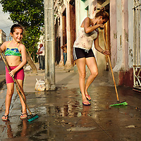 Mother and daughter in weekend chores.