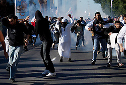 © under license to London News Pictures. 19/02/2011. Protesters run from tear gas and rubber bullets after being fired upon by police during a march to Pearl Roundabout in Manama, Bahrain today (19/02/2011). Thousands of people have returned to Bahrain's Pearl roundabout after both the army and the police leave the anti-government protest site. Photo credit should read Michael Graae/London News Pictures