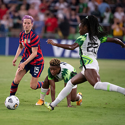 USA forward MEGAN RAPINOE (15) challenges RITA CHIKWELU (10) and MICHELLE ALOZIE (22) of Nigeria during the second half of the US Women's National Team (USWNT) 2-0 victory over Nigeria, in the first match at Austin's Q2 Stadium. The U.S. women's team, an Olympic favorite, is wrapping up a series of summer matches to prep for the Tokyo Games. Press scored a goal in the win for USA Soccer.