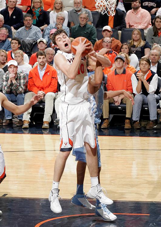 Virginia forward/center Mike Tobey (10) grabs a rebound during an NCAA basketball game against Virginia Monday Jan. 20, 2014 in Charlottesville, VA. Virginia defeated North Carolina 76-61.